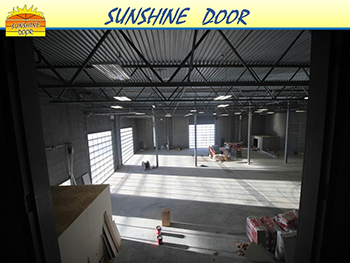 Light-thru-Sunshine-Door-in-warehouse-Brandon-Winnipeg