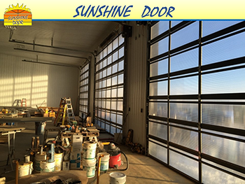 Visible-light-thru-Sunshine-Door-commercial-work-bays-Brandon-Winnipeg